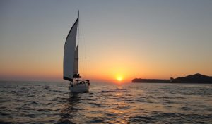 Barca's sailing boat making a tour at sunset hours