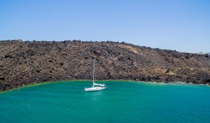 Barca's sailing boat on a private morning excursion at santorini floating
