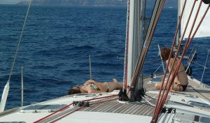 Two women relaxing on the deck of barca's sailing boat