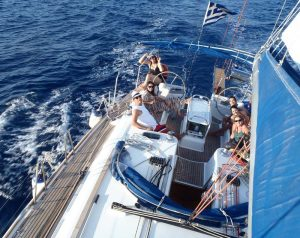 barca sailing boat on morning cruise in Santorini with a nice company on vacation