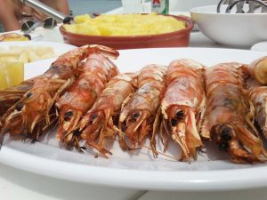 A tasty greek dish of crayfish and other dishes at Barca's Boat Santorini