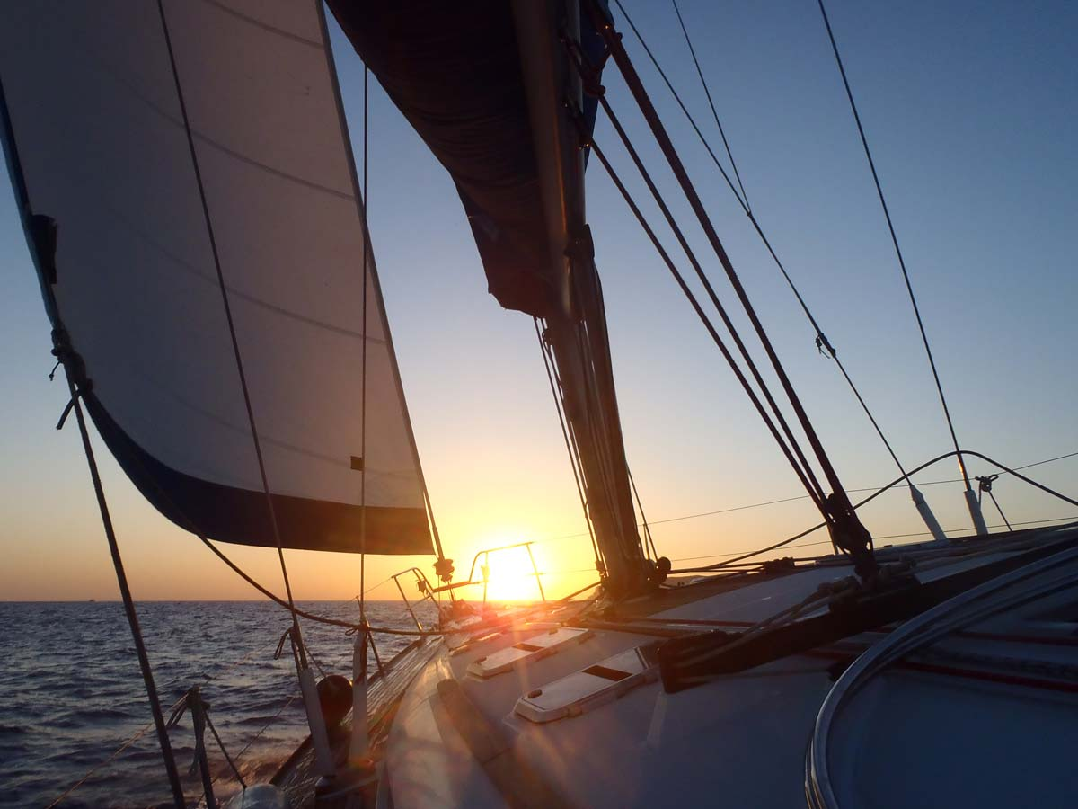 Barca's sailing boat on a private sunset excursion at santorini