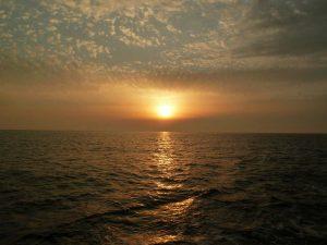 sunset in Santorini from inside the boat