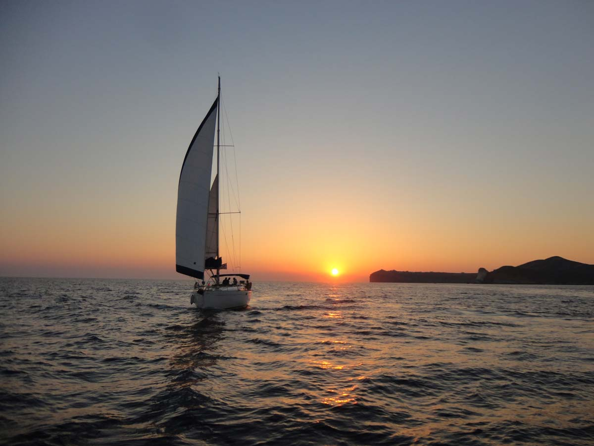 Barca's sailing boat floating in front of the sunset