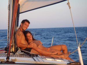 A beautifull couple relaxing on the deck of Barca's sailing boat in Santorini