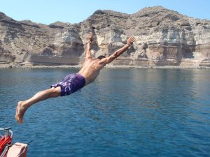 someone diving from Barca's boat on a stop for relaxing and swimming