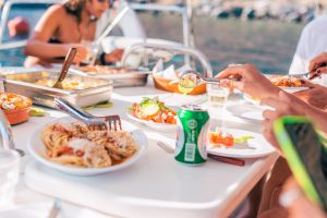 tasty greek dishes and drinks at Barca's boat excursions waiting customers to enjoy them